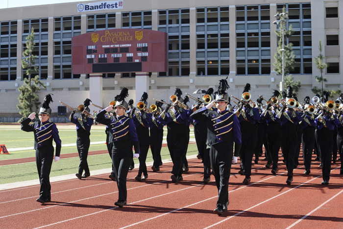 """After the WCU band performed """"Rock U,"""" the group """"trooped the stands"""" by marching on the track by the crowd."""