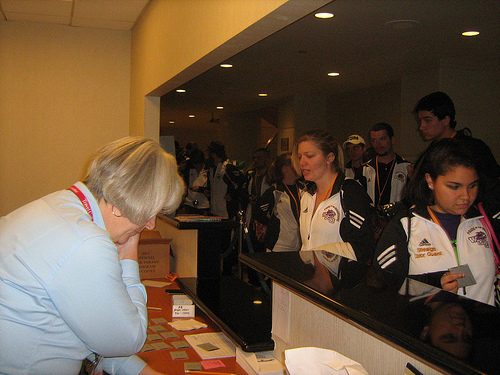 Travel Gallery staff members help check WCU students in to the Hyatt in Anaheim late Tuesday, Dec. 28.