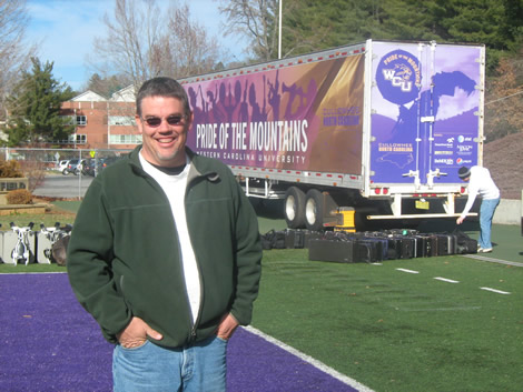Jimmy Crocker, one of the volunteer truck drivers, has a daughter in the band. Crocker spent his birthday - Dec. 26 - driving a truck with band equipment inside westbound for the band.
