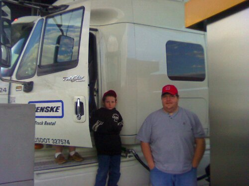 Volunteer truck driver Marion Ferguson (right) and his son Harlie are part of the crew driving band equipment west for the Tournament of Roses.