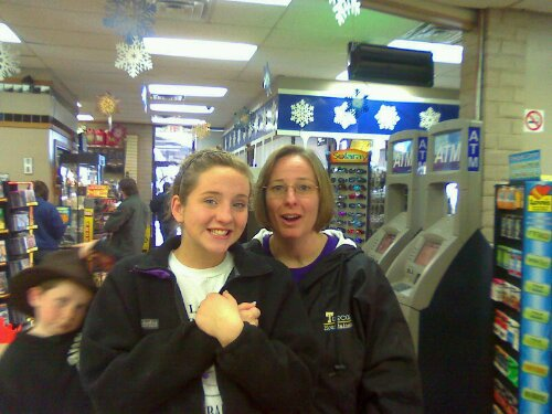 Carol Ferguson (right) and her daughter Hannah took a break at a truck stop. Carol Ferguson acquired a Class A license just to help drive the band trucks to California for the Tournament of Roses.