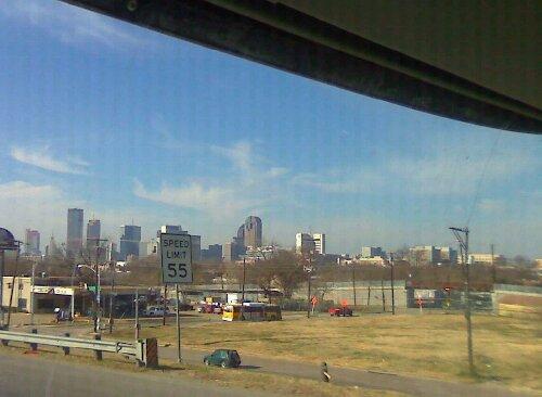 The trucks pass downtown Dallas.