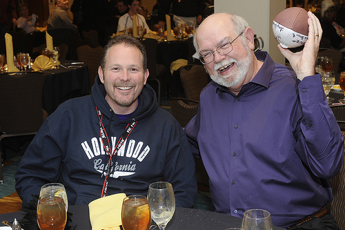 From left, assistant band director Matt Henley and WCU alumnus John Anderson catch up during the celebration of the arrival of 2011.