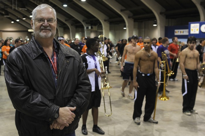 Bill Locklear, who arranges music for the WCU marching band, traveled to California to see them perform at the Tournament of Roses and attended a rehearsal held indoors (pictured) because of rain.