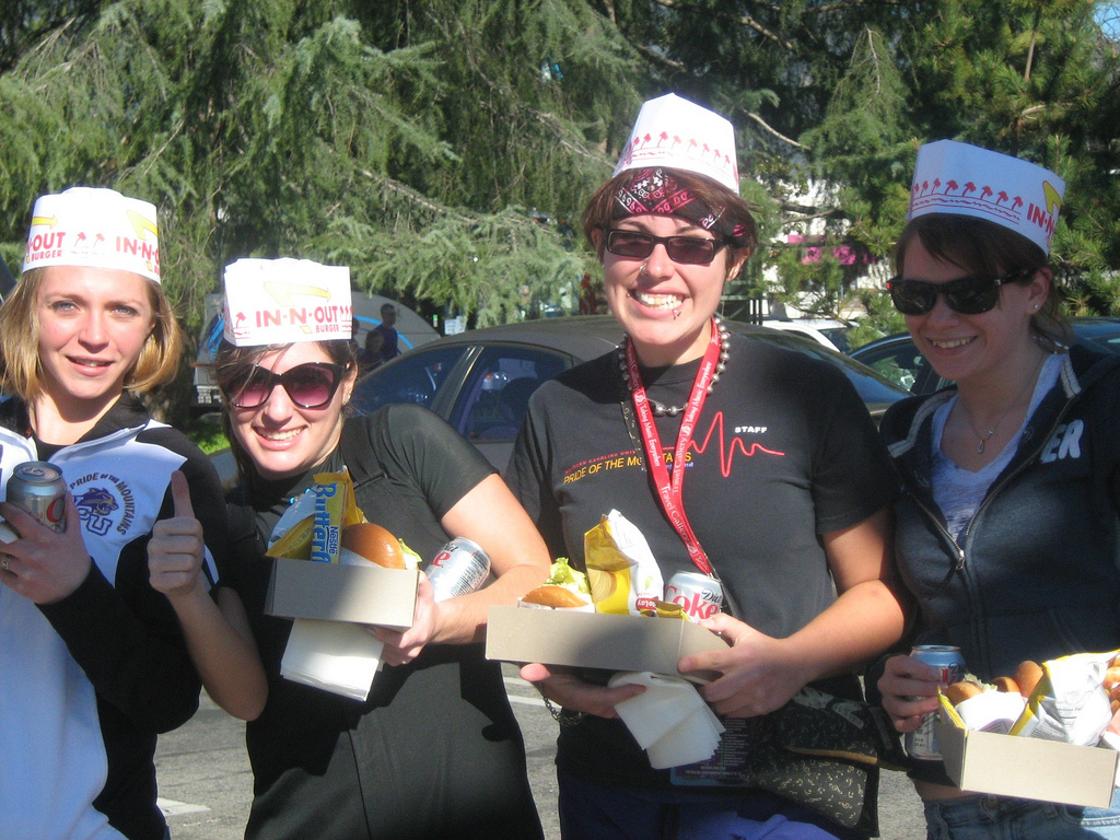 "The WCU Pride of the Mountains Marching Band enjoyed a burger, potato chips, Butterfinger and soft drink and donned hats from In-N-Out Burger after performing the field show ""Rock U"" in the Tournament of Roses Bandfest."