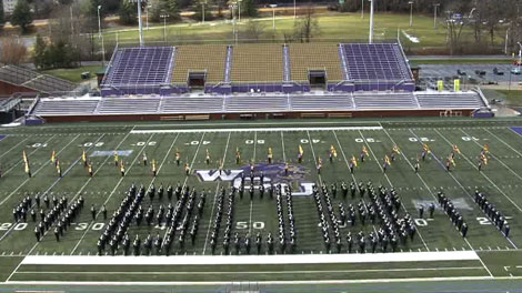 "The band spells ""Bob"" on the field in honor of director Bob Buckner at the end of a fundraising event in which the group spelled names of major supporters on the field"