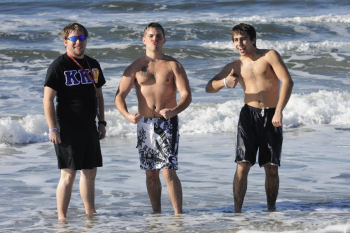 Students take a dip in the Pacific Ocean.