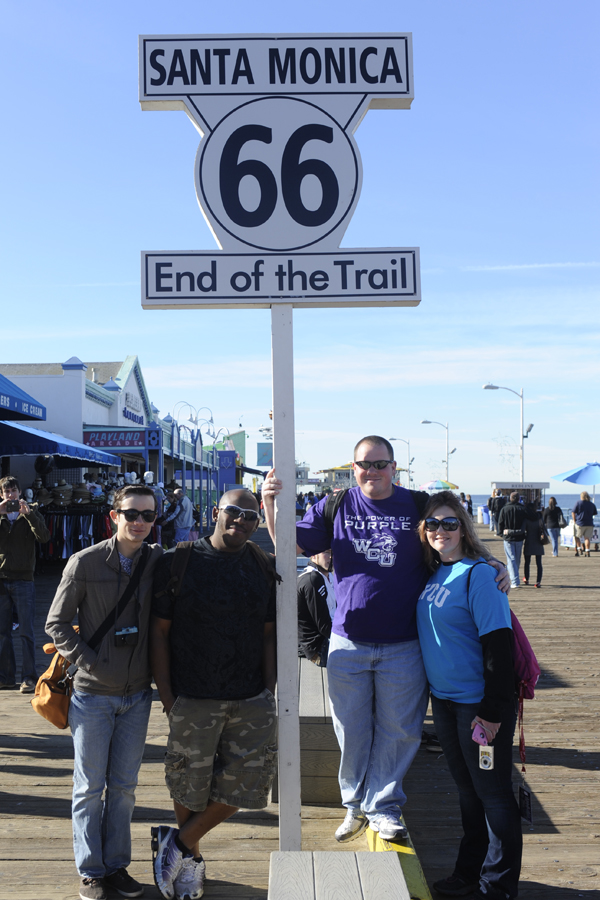 Students pose with the Santa Monica sign.
