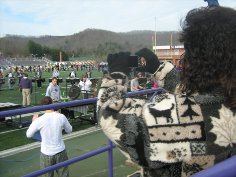 Beverly Pruett, a Forest City resident whose son Billy Epley was a member of the Western Carolina University Pride of the Mountains Marching Band when he died in 2005, takes pictures at the band's last rehearsal before the group performs in the 2011 Rose Parade and Tournament of Roses Bandfest.