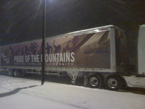 The Pride of the Mountains Mraching Band truck wrap shows up against the snow in the early morning Dec. 26.
