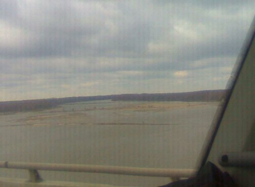 The trucks carrying band equipment cross over the Mississippi River.