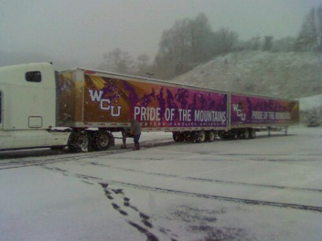 Drivers secure the trucks in the snow.